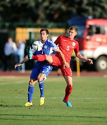John Stones of England (Everton) battles for the ball with Adolfo Jose Hirsch of San Marino (S.S. Folgore)  - Mandatory byline: Joe Meredith/JMP - 07966386802 - 05/09/2015 - FOOTBALL- INTERNATIONAL - San Marino Stadium - Serravalle - San Marino v England - UEFA EURO Qualifers Group Stage