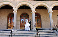 """Bride Patricia Ann O'Grady outside Sacred Heart Church prior to her wedding ceremony in Yonkers, NY on Friday, September 6, 2002. Quote from Best Man, Dennis Meyers; """"Together forever in health and happiness, Greg and Tricia, forever."""" (Photograph by Chet Gordon for The New York Daily News)"""