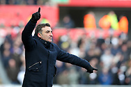 Swansea city manager Carlos Carvalhal signals to his players from the touchline. The Emirates FA Cup, quarter-final match, Swansea city v Tottenham Hotspur at the Liberty Stadium in Swansea, South Wales on Saturday 17th March 2018.<br /> pic by  Andrew Orchard, Andrew Orchard sports photography.