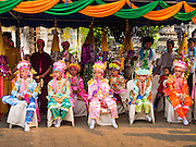 """05 APRIL 2015 - CHIANG MAI, CHIANG MAI, THAILAND: Tai Yai boys being ordained as Buddhist monks watch a folklore show during the second day of the three day long Poi Song Long Festival in Chiang Mai. The Poi Sang Long Festival (also called Poy Sang Long) is an ordination ceremony for Tai (also and commonly called Shan, though they prefer Tai) boys in the Shan State of Myanmar (Burma) and in Shan communities in western Thailand. Most Tai boys go into the monastery as novice monks at some point between the ages of seven and fourteen. This year seven boys were ordained at the Poi Sang Long ceremony at Wat Pa Pao in Chiang Mai. Poy Song Long is Tai (Shan) for """"Festival of the Jewel (or Crystal) Sons.    PHOTO BY JACK KURTZ"""