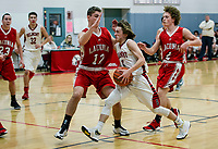 Laconia's Ryan Paiva puts pressure on Belmont's Griffin Embree during NHIAA Division III Basketball Tuesday evening.  (Karen Bobotas/for the Laconia Daily Sun)