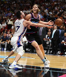 November 12, 2018 - Miami, FL, USA - The Heat's Kelly Olynyk is fouled by the 76ers' J.J. Redick in the second quarter as the Miami Heat host the Philadelphia 76ers on Monday, Nov. 12, 2018 at American Airlines Arena in Miami. (Credit Image: © Patrick Farrell/Miami Herald/TNS via ZUMA Wire)