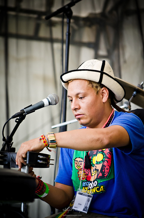 Pedrito of Gogol Bordello setting up his percussion equipment prior to the band's performance at the 2011 Appel Farm Arts & Music Festival in Elmer, NJ.