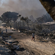 MORIA, GREECE - SEPTEMBER 10: Fires which started Tuesday night continue to rage into Thursday inside of Moria camp on September 10, 2020 in Moria. According to UNHCR, current numbers say the asylum-seekers displaced from the encampment are around 12,000. (Photo by Byron Smith/Getty Images)