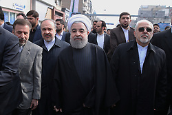 Iranian President Hassan Rouhani walks down a street in the capital Tehran during a ceremony to mark the 38th anniversary of the Islamic revolution on February 10, 2017. Photo by Parspix/ABACAPRESS.COM