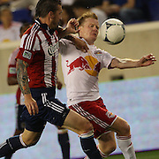 New York Red Bulls player Dax McCarty (right) is challenged by Danny Califf, Chivas USA, during the New York Red Bulls V Chivas USA Major League Soccer match at Red Bull Arena, Harrison, New Jersey, 23rd May 2012. Photo Tim Clayton