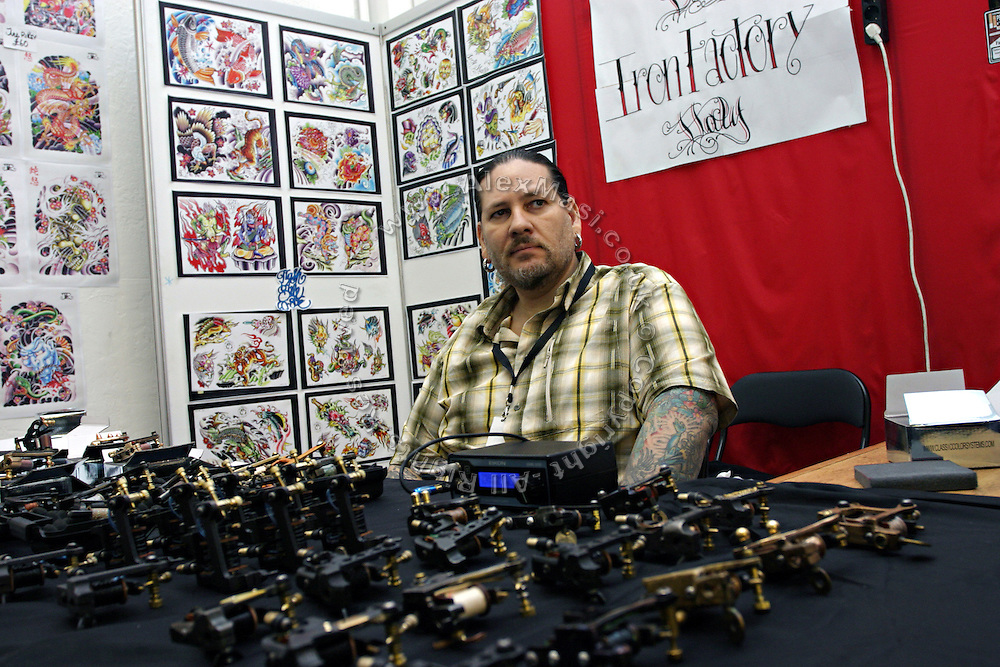 Portrait of a tattoo artist selling tattoo machines at the 2nd International Tattoo Convention in London on Saturday, Oct. 7, 2006, in London, UK. With over 15.000 visitors in three days during the 2005 edition, the event placed London in a central position in the tattoo world.  This year about 150 artists ,representing all the tattoo styles, are ticking away with their machines in a very exciting atmosphere. **ITALY OUT**....