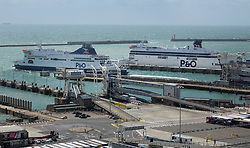 © Licensed to London News Pictures. 28/07/2018. London, UK. A ferry leaves as another arrives at the Port of Dover. There are long queues at the port of Dover in Kent as holiday-makers wait for their ferry after getting through border control. There are currently wait times of over 2 hours at the approach roads and at border controls. Photo credit: Peter Macdiarmid/LNP