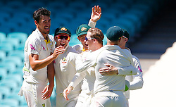 Australia's Steve Smith is congratulated after he took the catch to dismiss England's Dawid Malan during day two of the Ashes Test match at Sydney Cricket Ground.