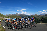 """France - Tuesday, Jul 22 2008: The """"grupetto"""" climbs the Col de Restefond during Stage 16 of the 2008 Tour de France cycle race. (Photo by Peter Horrell / http://www.peterhorrell.com)"""