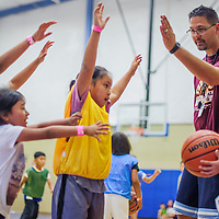 Coach Chad Musch instructs players during the True Hoops Basketball Camp Thursday at Rehoboth High School.