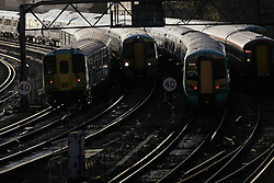 © Licensed to London News Pictures. 20/12/2011, London, UK.  Trains leave and arrive at Victoria station in London, Tuesday, Dec. 20, 2011. Train fares will rise by an average of 5.9 percent in January 2012, the Association of Train Operating Companies has said Tuesday. Photo credit : Sang Tan/LNP