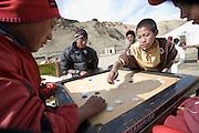 LADAKH, HIMALAYA, INDIA: Kids playing Carrom, a local version of billiard, at Tso Moriri Lake, in the Himalayan region of Ladakh, India.
