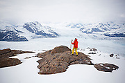 Ian Howat, glaciologist with Ohio State University, prepares to resurvey, with modern GPS, an old ground control point established by the USGS in an early study of the Columbia Glacier, near Valdez, Alaska. Resurveying will allow old and new data to be linked so as to precisely quantify, from the late 1970s to present, the dramatic retreat of the glacier.