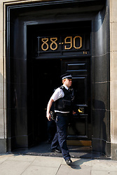 © Licensed to London News Pictures. 08/04/2015. LONDON, UK. Detectives and scenes of crime officers carrying out a forensic examination of the scene at Hatton Garden Safety Deposit Ltd in London on Wednesday, 8 April 2015. Police believes that approximately 60 - 70 safety deposit boxes were opened during the burglary over Easter weekend. Photo credit : Tolga Akmen/LNP