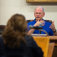 City Councilor Allan Landavazo listens as Greater Gallup Economic Development Corporation Executive Director Patty Lundstrom speaks at a city council meeting Tuesday, Sept. 10 in Gallup.