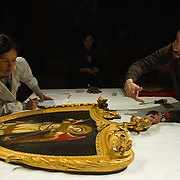PADOVA, ITALY - APRIL 13:  Two technicians check one of the Angels paintings by Guariento which will be on display on April 13, 2011 in Padova, Italy. The Guariento exhibition will be open from April 16th until July 31st in the renovated Foundation Cariparo in Piazza del Duomo.
