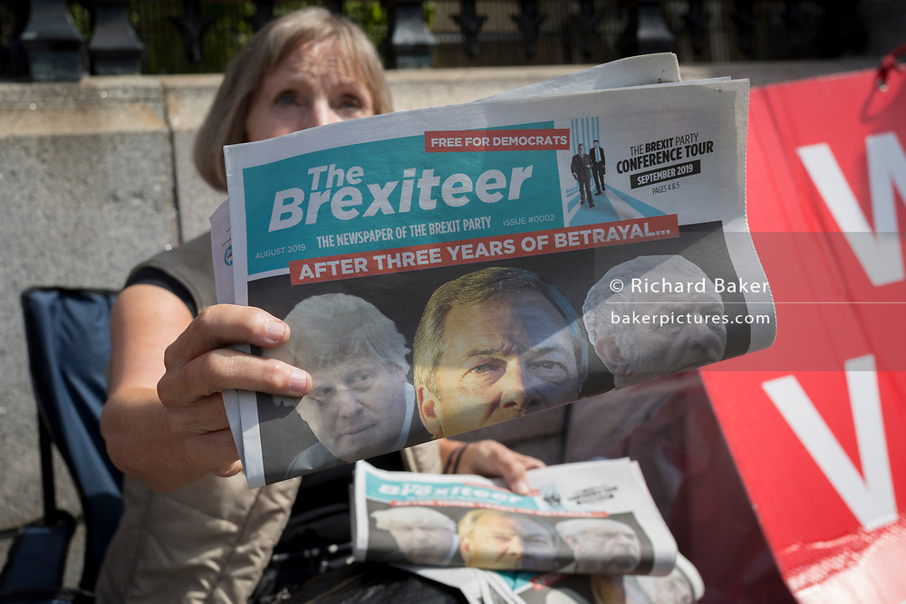 On the day that rebel Conservative Party rebels and opposition MPs attempt to pass a law designed to prevent a no-deal Brexit by the government of Prime Minister Boris Johnson, a Brexiteer hands out free copies of the The Brexiteer, the newspaper of Nigel Farage's Brexit Party, outside Parliament, on 3rd September 2019, in Westminster, London, England.