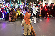UNITED KINGDOM, London: 28 May 2017 A young boy dressed as an Ewok interrupts a photo shoot of other Star Wars cosplay fans at the MCM London Comic Con. <br /> The comic convention, which will be visited by tens of thousands of comic book and cosplay fans, is being held at London's ExCel this weekend. Rick Findler / Story Picture Agency