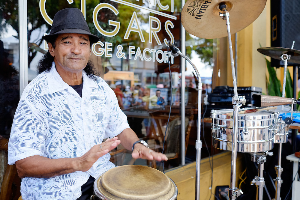 MIAMI - MARCH 9, 2014: Portrait of musician with drums during the 37th Calle Ocho festival, an annual event that takes place over Eight Street in Little Havana featuring plenty of music, food, and  it is the biggest party in town that celebrates hispanic heritage.