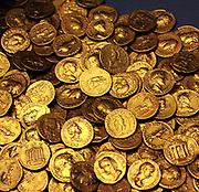 Corbridge hoard and jug. Corbridge, Northumberland (UK), about AD 160 These 160 gold aureus coins were found below the floor of a Roman house in Corbridge in 1911. They were stored in a bronze jug, their true value hidden by two bronze coins wedged in its neck.