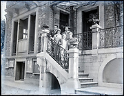 well off family posing on the stairs in front of the house France, circa 1930s