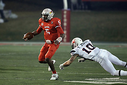 11 December 2015:   Trevor Jones misses on a chance to catch Tre Roberson(5) who is moving upfield on an option. NCAA FCS Quarter Final Football Playoff game between Richmond Spiders and Illinois State Redbirds at Hancock Stadium in Normal IL (Photo by Alan Look)