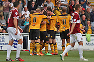 Chris Jones of Newport is mobbed after scoring his side's second goal. Skybet football league two match, Newport county v Northampton Town at Rodney Parade in Newport, South Wales on Saturday13th Sept 2014<br /> pic by Mark Hawkins, Andrew Orchard sports photography.