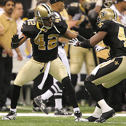 Jan 24, 2010; New Orleans, LA, USA; New Orleans Saints safety Darren Sharper (42) celebrates with safety Roman Harper (41) after forcing a Minnesota Vikings punt during the second quarter of the 2010 NFC Championship game at the Louisiana Superdome. Mandatory Credit: Derick E. Hingle-US PRESSWIRE