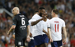 England's Darren Bent (centre) celebrates scoring his side's first goal of the game with Olly Murs (right) during the UNICEF Soccer Aid match at Old Trafford, Manchester.