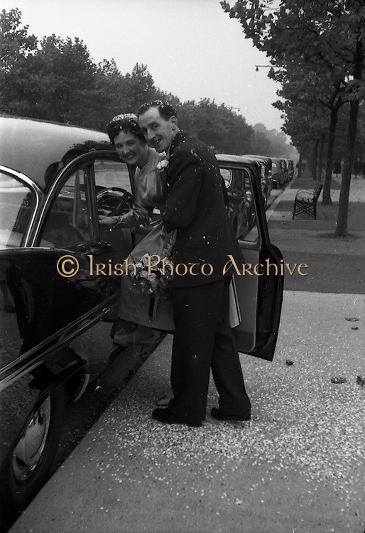 08/10/1959<br /> 10/08/1959<br /> 08 October 1959<br /> Wedding:Kenny - Colgan  (Muriel? and Tommy) at Church of St. Vincent de Paul, Griffith Avenue and the Grand Hotel, Malahide, Dublin. The couple getting into the car outside the church after the  the wedding service.