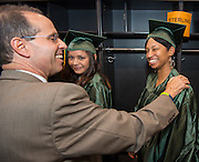 Sharpstown principal Robert Gasparello, left, greets Samiya Jene'e Savannah, right, before graduation ceremonies at Delmar Fieldhouse, August 17, 2013. Savannah completed her course work at Sharpstown High School in 1996 but did not pass the standard exam required to graduate. She eventually got a GED and went to college. She decided to complete the required test and walk at graduation to have a diploma like her oldest son.