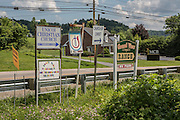 Signs at the exit of Tennessee highway 173 near the entrance to the little town of Unicoi, in Unicoi County, Tennessee.