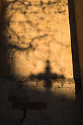Shadow of a cross on the wall of the Monastery of Sant Cugat, Barcelona, Catalonia, Spain. Monestir de Sant Cugat, Catalunya, Espanya