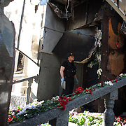 An official forensic inspector analyses the destroyed headquarters of Mariupol's police, hours after deadly confrontations between armed separatist groups and the Ukrainian army took place throughout the city.