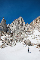 Hiker on approach to Mount Whitney via Mountaineers Route, Sierra Nevada Mountains, California