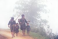 """A group of H'Mong on the way to the Sunday market in Sapa, Northern Vietnam<br /> Available as Fine Art Print in the following sizes:<br /> 08""""x12""""US$   100.00<br /> 10""""x15""""US$ 150.00<br /> 12""""x18""""US$ 200.00<br /> 16""""x24""""US$ 300.00<br /> 20""""x30""""US$ 500.00"""