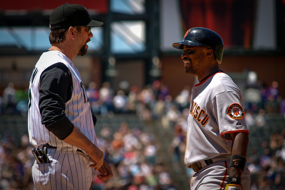 Colorado Rockies first baseman TODD HELTON #17 and Giants second baseman RAY DURHAM #5 have a friendly discussion during a 7-10 loss to the San Francisco Giants at Coors Field.