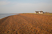 Bungalow house on the beach at the coastal hamlet of Shingle Street, Suffolk, England
