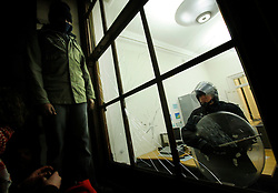 © under license to London News Pictures. A policemen protects the broken windows of the treasury as London student protests turn violent after the vote in parliament (09/12/10). Photo credit should read: Olivia Harris/ London News Pictures