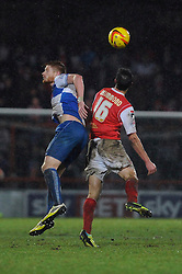 Bristol Rovers' Matt Harrold challenges Morecambe's Stewart Drummond to the ball in the air - Photo mandatory by-line: Dougie Allward/JMP - Tel: Mobile: 07966 386802 14/12/2013 - SPORT - Football - Morecombe - Globe Arena - Morecombe v Bristol Rovers - Sky Bet League Two