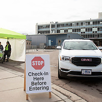 Gallup Indian Medical Center employees question patients for symptoms of coronavirus before they enter the hospital, Thursday, March 12 in Gallup.