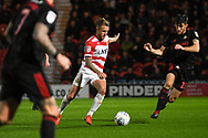 James Coppinger of Doncaster Rovers (26) looks to pass the ball forward, under attention from Herbie Kane of Doncaster Rovers (15) during the EFL Sky Bet League 1 match between Doncaster Rovers and Sunderland at the Keepmoat Stadium, Doncaster, England on 23 October 2018.