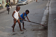 Small boys playing in the street, Trenchtown, Kingston, Jamaica.