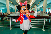 Minnie Mouse with passengers, Disney Cruise Line terminal (passengers boarding the Disney Dream), Port Canaveral, Florida USA