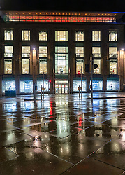 Edinburgh, Scotland, UK. 19 December 2020.  Views of streets and shops in Edinburgh City Centre on evening that Scottish Government announced the highest level 4 lockdown will be enforced from Boxing Day in Scotland.  Pic; Harvey Nichols store very quiet at night in the rain. Iain Masterton/Alamy Live News