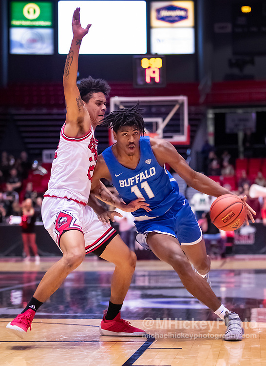 DEKALB, IL - JANUARY 22: Jeenathan Williams #11 of the Buffalo Bulls drives to the basket during the game against Rod Henry-Hayes #22 of the Northern Illinois Huskies at NIU Convocation Center on January 22, 2019 in DeKalb, Illinois. (Photo by Michael Hickey/Getty Images) *** Local Caption *** Jeenathan Williams; Rod Henry-Hayes