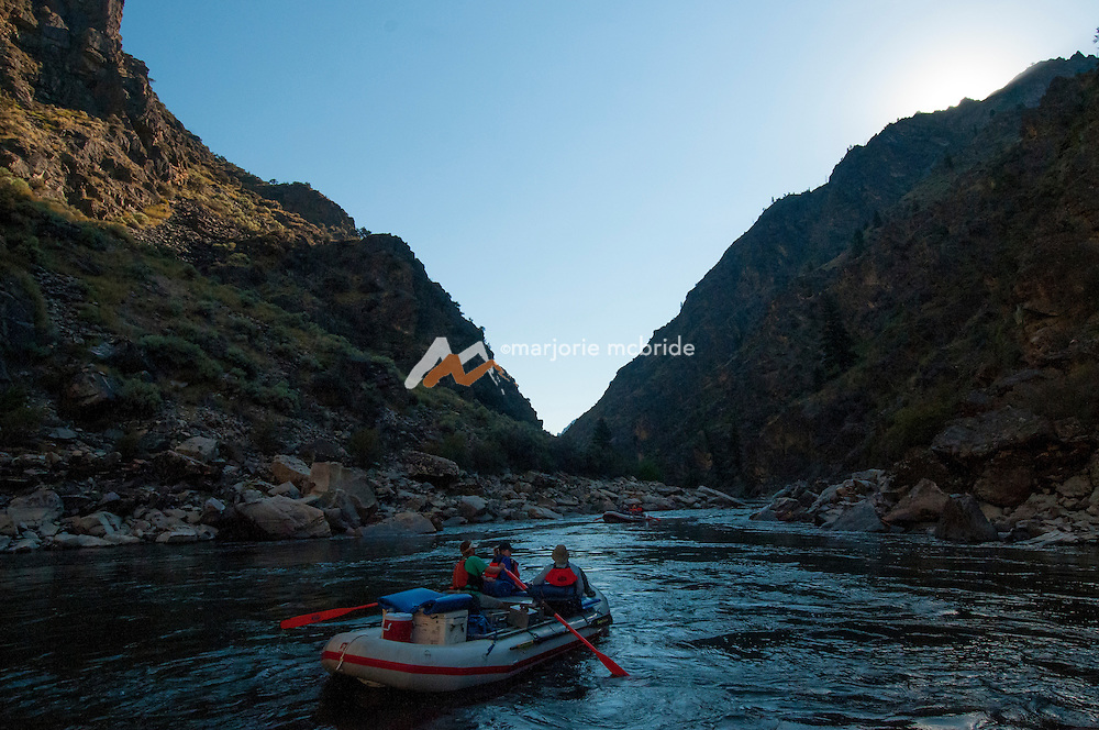 Deep inshadow just before the sun clears the peaks in The Impassible Canyon on the Middle Fork of the Salmon River during six day rafting vacation, Idaho.