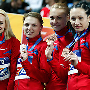(L-R) Russia's relay team Yuliya Gushchina, Kseniya Ustalova, Marina Karnaushchenko and Aleksandra Fedoriva pose on the podium with their bronze medals during the medal ceremony for the women's 4x400m relay during the IAAF World Indoor Championships at the Atakoy Athletics Arena, Istanbul, Turkey. Photo by TURKPIX