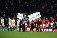 the ground staff are quick to remove the post pads as Wales players celebrate their win.Rugby World Cup 2015 pool A match, England v Wales at Twickenham Stadium in London, England  on Saturday 26th September 2015.<br /> pic by  Andrew Orchard, Andrew Orchard sports photography.